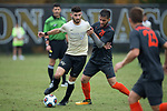 Jon Bakero (7) of the Wake Forest Demon Deacons keeps the ball away from Rodrigo Zampieri (20) of the Virginia Tech Hokies during second half action at Spry Soccer Stadium on November 5, 2017 in Winston-Salem, North Carolina.  The Demon Deacons defeated the Hokies 3-0.  (Brian Westerholt/Sports On Film)
