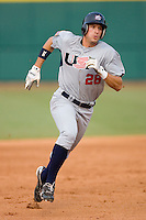 Buck Coats #28 of Team USA hustles towards third base versus Team Canada at the USA Baseball National Training Center, September 4, 2009 in Cary, North Carolina.  (Photo by Brian Westerholt / Four Seam Images)