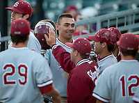 STOCKTON, CA - May 9, 2011: Tyler Gaffney of Stanford baseball is congratulated after scoring another run during Stanford's game against Pacific at Klein Family Field in Stockton. Stanford won 11-5.