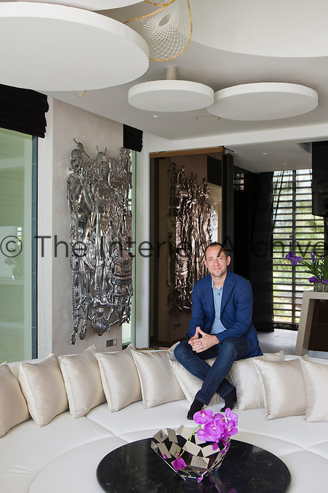 Graham Lamb, the hotel's chief designer and architect, in the living area of the Iniala penthouse