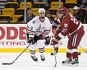 Drew Ellement (NU - 2), Michael Biega (Harvard - 27) - The Northeastern University Huskies defeated the Harvard University Crimson 4-1 (EN) on Monday, February 8, 2010, at the TD Garden in Boston, Massachusetts, in the 2010 Beanpot consolation game.