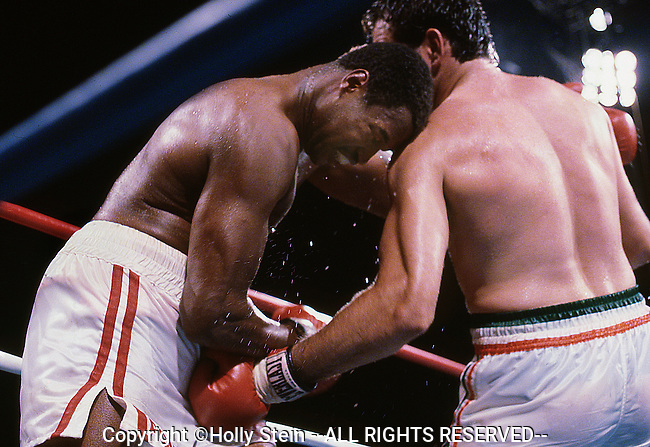 Gerry Cooney (R) delivers a low blow to Larry Homes during their WBC heavyweight championship fight.  Holmes W TKO13.