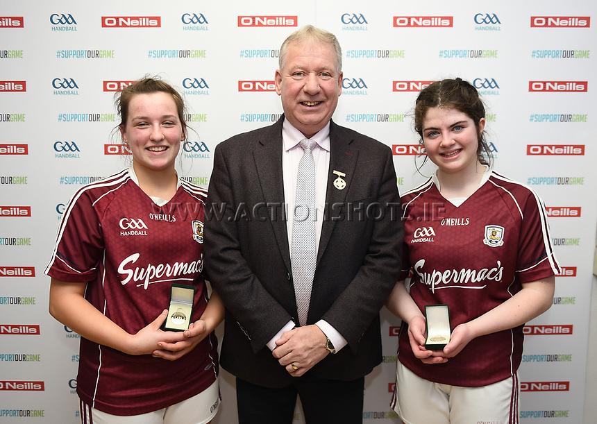 19/03/2018; 40x20 All Ireland Juvenile Championships Finals 2018; Kingscourt, Co Cavan;<br /> Girls Under-17 Doubles; Galway (Orla Whyte/Aoife Nic Dhonnacha) v Limerick (Ciara McCarthy/Keri Murphy)<br /> Ciara McCarthy and Orla Whyte with GAA Handball President Joe Masterson<br /> Photo Credit: actionshots.ie/Tommy Grealy