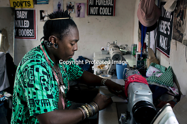 SOWETO, SOUTH AFRICA FEBRUARY 2: Sibu Sithole, a young designer part of the group Smarteez work on a collection in his workshop on February 2, 2014 in Jabulani section of Soweto, South Africa. They mostly sell their garments to private clients who visit the workshop. The population is estimated to around one million people. Soweto is a mix of old housing and newly constructed townhouses. A new hungry black middle-class is growing steadily. Many residents work in Johannesburg but the last years many shopping malls have been built, and people are starting to spend their money in Soweto. (Photo by: Per-Anders Pettersson)