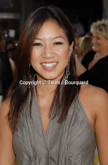 Michelle Kwan arriving at The Simpsons, The Movie Premiere at the Westwood Theatre in Los Angeles.<br /> <br /> headshot<br /> eye contact<br /> gray dress