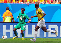 BRASILIA - BRASIL -19-06-2014. JPablo Armero (#7) jugador de Colombia (COL) disputa el balón con Max Gradel (#15) jugador de  Costa de Marfil (CIV) durante partido del Grupo C de la Copa Mundial de la FIFA Brasil 2014 jugado en el estadio Mané Garricha de Brasilia./ Pablo Armero (#7) player of Colombia (COL) fights the ball with Max Gradel (#15) player of Ivory Coast (CIV) during the macth of the Group C of the 2014 FIFA World Cup Brazil played at Mane Garricha stadium in Brasilia. Photo: VizzorImage / Alfredo Gutiérrez / Contribuidor