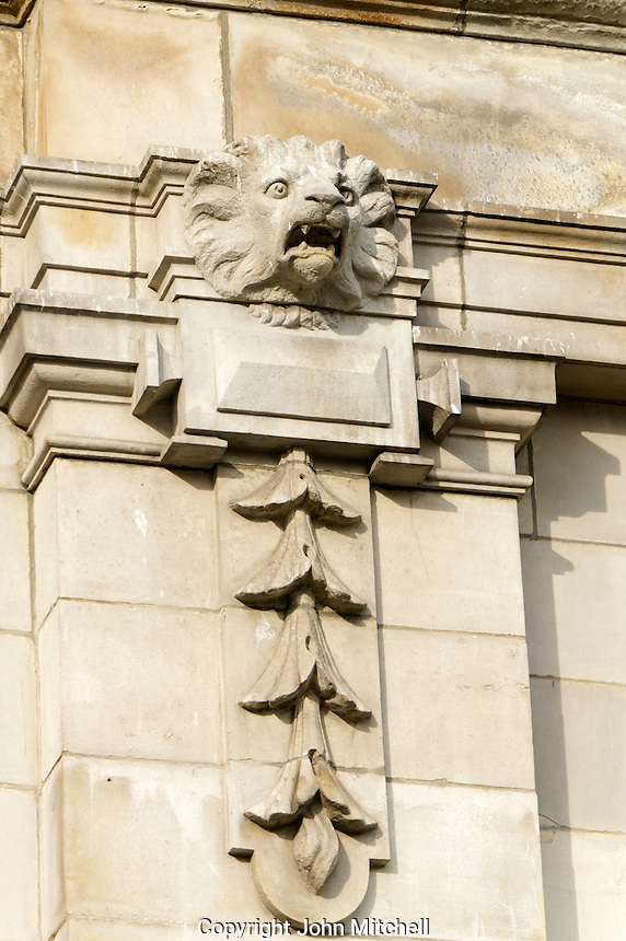 Stone lion head sculpture on the neoclassical facade of the Vancouver Art Gallery building, Vancouver, BC, Canada