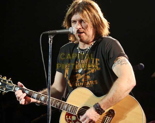 BILLY RAY CYRUS .Special performance during a sold-out show at the world famous Wildhorse Saloon, Nashville, Tennessee, USA..December 27th, 2008.half length stage concert live gig music black singing guitar tattoo .CAP/ADM/RR.©Randi Radcliff/AdMedia/Capital Pictures.