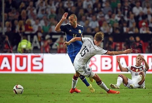 03.09.2014. Esprit Arena, Düsseldorf, Germany. International football friendly match. Javier Mascherano (Arg) challenged by Eric Durm (Ger)