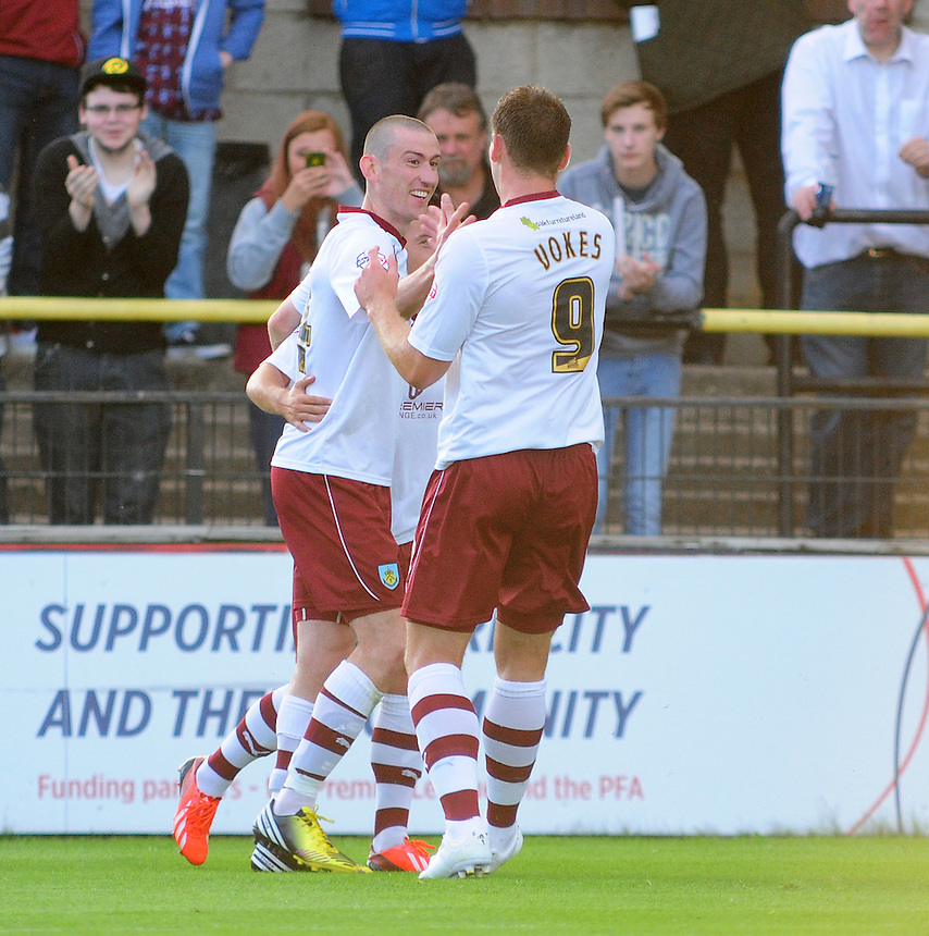 Burnley's David Jones celebrates scoring the opening goal with team-mate Sam Vokes <br /> <br /> (Photo by Chris Vaughan/CameraSport<br /> <br /> Football - Capital One Cup First Round - York City v Burnley - Tuesday 6th August 2013 - Bootham Crescent - York<br />  <br /> &copy; CameraSport - 43 Linden Ave. Countesthorpe. Leicester. England. LE8 5PG - Tel: +44 (0) 116 277 4147 - admin@camerasport.com - www.camerasport.com