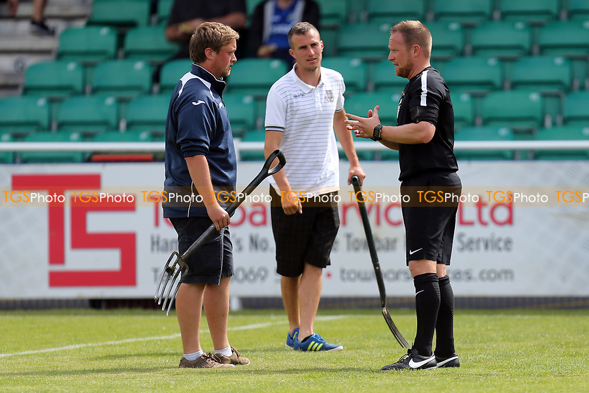 Referee David Rock speaks to the groundsman about areas of the pitch being soft during Eastleigh vs Dagenham & Redbridge, Vanarama National League Football at the Silverlake Stadium on 12th August 2017