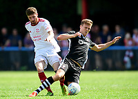 Lincoln United's Matt Cotton is tackled by Lincoln City's Sean Raggett<br /> <br /> Photographer Chris Vaughan/CameraSport<br /> <br /> Football - Pre-Season Friendly - Lincoln United v Lincoln City - Saturday 8th July 2017 - Sun Hat Villas Stadium - Lincoln<br /> <br /> World Copyright &copy; 2017 CameraSport. All rights reserved. 43 Linden Ave. Countesthorpe. Leicester. England. LE8 5PG - Tel: +44 (0) 116 277 4147 - admin@camerasport.com - www.camerasport.com