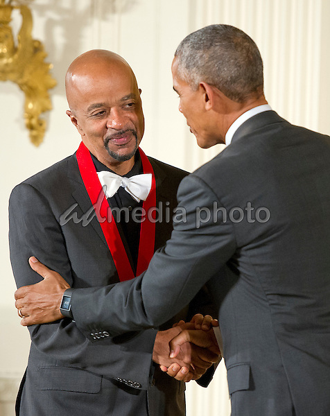United States President Barack Obama presents the 2015 National Humanities Medal to James McBride, Author of Lambertville, New Jersey, during a ceremony in the East Room of the White House in Washington, DC on Thursday, September 22, 2016. Photo Credit: Ron Sachs/CNP/AdMedia