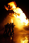 Pix: Shaun Flannery/shaunflanneryphotography.com...COPYRIGHT PICTURE>>SHAUN FLANNERY>01302-570814>>07778315553>>..21st March 2005……………..Fire crews at Robin Hood Airport Doncaster Sheffield practice on the newly installed fire rig.