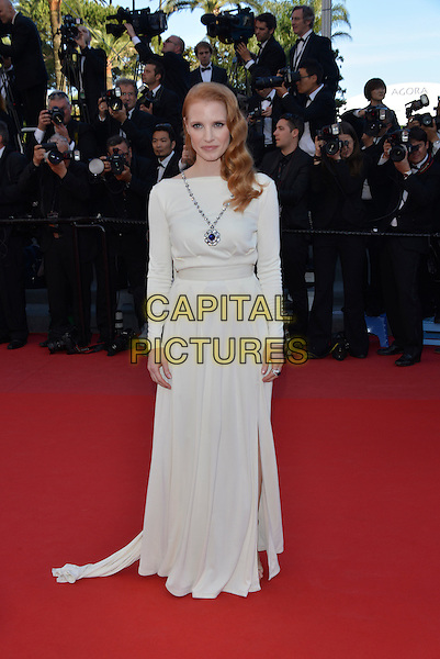 Jessica Chastain.'Cleopatra' premiere at the 66th  Cannes Film Festival, France..21st May 2013.full length white dress silver necklace long sleeves .CAP/PL.©Phil Loftus/Capital Pictures.