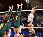 BROOKINGS, SD - OCTOBER 26:  Tiara Gibson #7 from South Dakota State tries for a kill past a pair of defenders including Emily Minnick #3 from North Dakota State in the third game of their match Saturday evening at Frost Arena in Brookings. (Photo by Dave Eggen/Inertia)