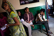 Patients are seen waiting outside the eye doctors' clinic in Maharani Laxmibai Medical College in Jhansi, Uttar Pradesh, India. The Indian government spends $1.4 billion a year - on programs that include weighing newborn babies, counseling mothers on healthy eating and supplementing meals, but none of this is yeilding results. According to UNICEF, some 48% of Indian children, or 61 million kids, remain malnourished, the clinical condition of being so undernourished that their physical and mental growth are stunted. Photo: Sanjit Das/Panos