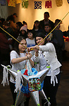 Latino Cohort members run the pi&ntilde;ata game at the Posada Celebration at Western Nevada College in Carson City, Nev., on Saturday, Dec. 16, 2017. <br /> Photo by Cathleen Allison/Nevada Momentum