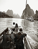 CHINA, Guilin, people travel on a boat down the Li River (B&W)