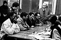 Immigrants coming from countries outside Europe at employment office in Milan, Italy, January 1990. © Carlo Cerchioli..Cittadini extracomunitari all'ufficio di collocamento di Milano, gennaio 1990. .