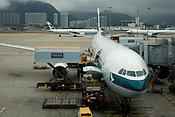 A Cathay Pacific Airbus A340 at a boarding gate at Hong Kong Airport.