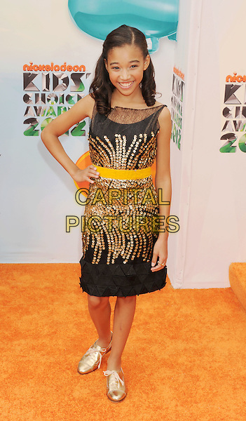 Amandla Stenberg.arriving at the 2012 Nickelodeon Kids' Choice Awards at Galen Center in Los Angeles, California, USA..March 31st, 2012.full length black gold dress yellow hand on hip.CAP/ROT/TM.©Tony Michaels/Roth Stock/Capital Pictures