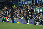 Opposing managers Roberto Martinez (left) and Tony Pulis giving differing reactions to an incident at Goodison Park, Liverpool during the Premier League match between Everton and West Bromwich Albion. The match ended in a 0-0 draw, despite the home team missing a first-half penalty by Kevin Mirallas. The game was watched by 34,739 spectators and left both teams languishing near the relegation zone.