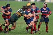 C. Glendinning tries to break past B. Crisp. Counties Manukau Premier Club Rugby, Pukekohe v Ardmore Marist played at the Colin Lawrie field, on the 27th of May 2006.Ardmore Marist won 22 - 6