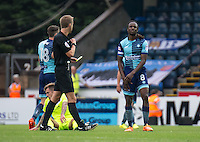 Referee John Brooks brandishes yet another yellow card this time to Marcus Bean of Wycombe Wanderers during the Sky Bet League 2 match between Wycombe Wanderers and Colchester United at Adams Park, High Wycombe, England on 27 August 2016. Photo by Liam McAvoy.