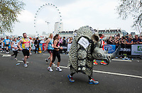 17 APR 2011 - LONDON, GBR - One of the infamous rhinos that runs the London Marathon for an animal protection charity .(PHOTO (C) NIGEL FARROW)