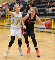 NWA Democrat-Gazette/ANDY SHUPE<br /> Kyrstin Brandscum (right) of Gravette drives around Skylar Campbell (2) of Pottsville Wednesday, Feb. 24, 2016, during the first half of play in the 4A North Regional Tournament in Tiger Arena in Prairie Grove. Visit nwadg.com/photos to see more photographs from the game.