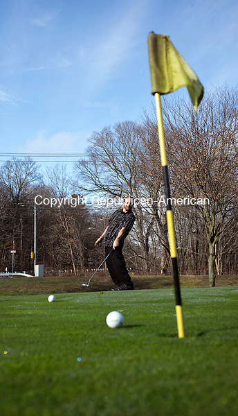 Naugatuck, CT- 27 December 2015-122715CM04- Demos Grivas of Naugatuck puts on the practice green at Hop Brook Golf Course in Naugatuck on Sunday.  Folks were out enjoying the warmer weather, which is expected to change.  According to the National Weather Service, Monday is expected to be mostly sunny, with a high near 37.  Christopher Massa Republican-American