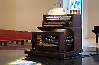 The Mildred Miles Crew '45 Memorial Organ in Occidental's Herrick Memorial Chapel and Interfaith Center was donated to the College in memory of Crew, who occasionally served as organist for Student Church services. She died in 1964. Manuel Rosales, president and tonal director of Rosales Organ Builders, has maintained the instrument, built by the Schlicker Organ Co., off and on since 1973. Though the organ was rarely used for some 15 years prior to its 50th birthday last October, Rosales, in conjunction with Kevin Cartwright of Cartwright Pipe Organ Co., undertook a major restoration on the neo-baroque-style instrument that was designed for the chapel by Clarence Mader, Occidental's professor of organ and College organist from 1955 to 1968.<br /> Photographed Oct. 22, 2016.<br /> (Photo by Marc Campos, Occidental College Photographer)
