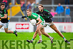 Tom Moriarty Legion gets to the ball ahead of Michael Dorgan Nemo Rangers during the AIB Munster club SFC clash in Pairc Uí Rinn on Sunday