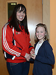 Senior ladies player Michaela O'Boyle presents under 12 girls player April Judge with her medal at the Newtown Blues juvenile awards presentations held in the Barbican Centre. Photo:Colin Bell/pressphotos.ie