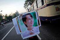 A vendor sells posters of Myanmar's pro-democracy leader Aung San Suu Kyi in central Yangon December 3, 2011. Aung San Suu Kyi welcomed on Friday renewed U.S. engagement with Myanmar, as U.S. Secretary of State Hillary Clinton wrapped up a landmark visit to a country that was ruled by the military for five decades until March this year.   REUTERS/Damir Sagolj (MYANMAR)