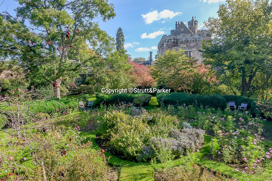 BNPS.co.uk (01202 558833)<br /> Pic: Strutt&Parker/BNPS<br /> <br /> Pictured: The castle has formal gardens, a kitchen garden, woodland, paddocks and grazing land, and an impressive arboretum, <br /> <br /> A stunning castle that once belonged to. swashbuckling sailor who killed the real-life Jack Sparrow has gone on the market for offers over £1.9m.<br /> <br /> Coupland Castle in Northumberland is Grade I listed and is steeped in history dating back to the 12th century.<br /> <br /> It's Pele Tower was the last fortified building to be constructed in the Border area and before that the land on which it was built belonged to Sir John de Coupland, who captured the Scottish King at the Battle of Neville's Cross in 1346.<br /> <br /> During the 18th century a separate farmhouse was added to the south-west of the now L-shaped tower and it was sold in 1713 to Sir Chaloner Ogle.
