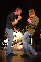 WEST PALM, FL - DECEMBER 08: Brad Arnold and Matt Roberts of 3 Doors Down perform at The Sound Advice Ampetheater.<br /> December 8, 2005 in West Palm , Florida. Credit: mpi04/MediaPunch