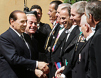 Il Presidente del Consiglio Silvio Berlusconi, sinistra, ed il sottosegretario di stato Gianni Letta, secondo da sinistra, salutano i Gentiluomini del Papa al suo arrivo alla Citta' del Vaticano, 6 giugno 2008..Italian Premier Silvio Berlusconi, left, and cabinet undersecretary Gianni Letta, second from left, shake hands with Pope's Gentlemen at his arrival at the Vatican, 6 june 2008..UPDATE IMAGES PRESS/Riccardo De Luca