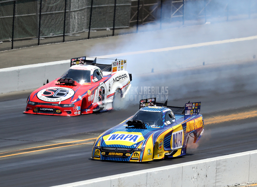 Jul 29, 2018; Sonoma, CA, USA; NHRA funny car driver Ron Capps (near) against Matt Hagan during the Sonoma Nationals at Sonoma Raceway. Mandatory Credit: Mark J. Rebilas-USA TODAY Sports