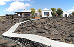 Garden path crossing solidified pahoehoe or ropey lava field, Tahiche, Lanzarote, Canary Islands, Spain