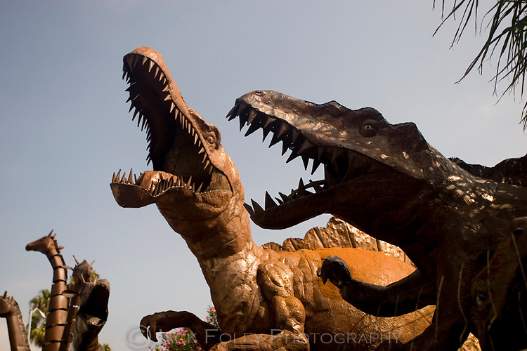 Large scary dinosaur sculptures made from bits of metal.