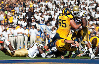 Kevin Riley scores the touchdown. The California Golden Bears defeated the UCLA Bruins 35-7 at Memorial Stadium in Berkeley, California on October 9th, 2010.
