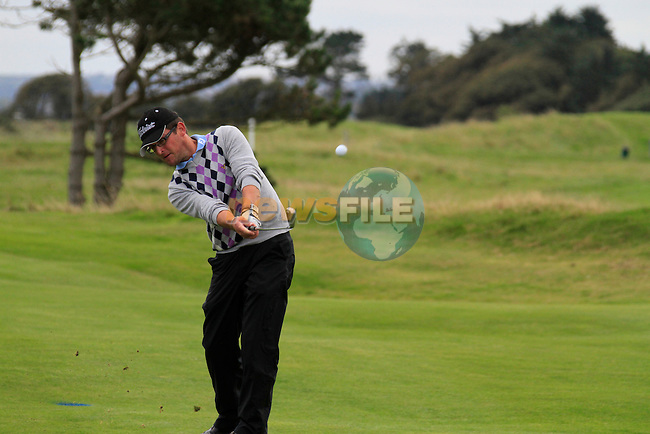 Glen Robinson plays his 2nd shot on the 18th hole during Day 3 of the 100th Irish PGA championship at Seapoint Golf Club, Co Louth...Picture Eoin Clarke/www.golffile.ie.