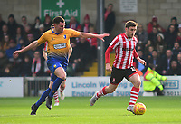 Lincoln City's Shay McCartan under pressure from Mansfield Town's Matt Preston<br /> <br /> Photographer Andrew Vaughan/CameraSport<br /> <br /> The EFL Sky Bet League Two - Lincoln City v Mansfield Town - Saturday 24th November 2018 - Sincil Bank - Lincoln<br /> <br /> World Copyright &copy; 2018 CameraSport. All rights reserved. 43 Linden Ave. Countesthorpe. Leicester. England. LE8 5PG - Tel: +44 (0) 116 277 4147 - admin@camerasport.com - www.camerasport.com