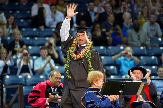 May 19, 2013; Manti Te'o waves to the audience after receiving his diploma at the Arts & Letters diploma ceremony in the Purcell Pavilion. Photo by Barbara Johnston/University of Notre Dame