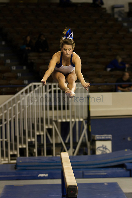 Junior Audrey Harrison displays her skill on the balance beam. in Lexington, Ky., on Thursday, December, 6, 2012. Photo by James Holt | Staff