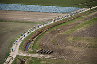 "Peloton riding the  gravel roads. <br /> <br /> Antwerp Port Epic 2018 (formerly ""Schaal Sels"")<br /> One Day Race: Antwerp > Antwerp (207km of which 32km are cobbles & 30km is gravel/off-road!)"
