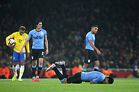 Luis Suarez of Uruguay lies on the grass after a challenge during Brazil vs Uruguay, International Friendly Match Football at the Emirates Stadium on 16th November 2018