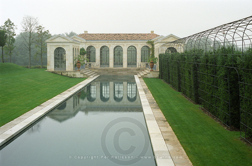 The  orangerie and pond in the garden a foggy morning. Chateau du Tertre, Margaux, Medoc, Bordeaux, France